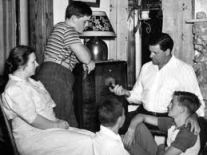 American family listening to the radio